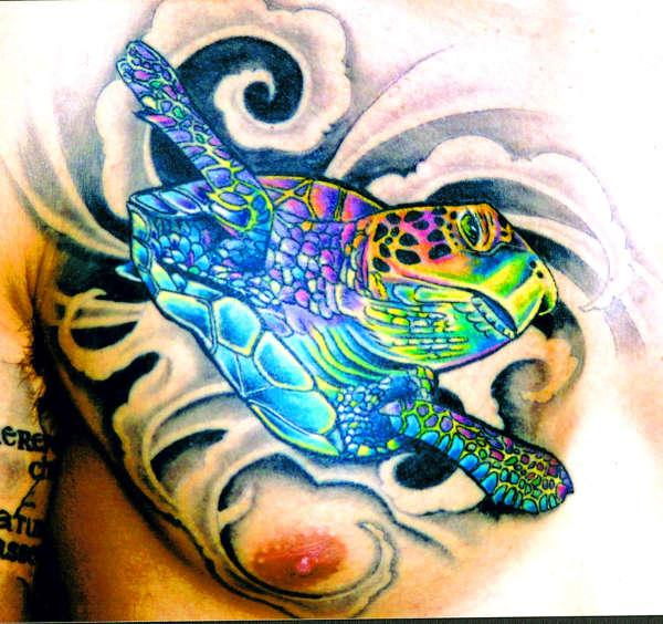 blue turtle on cheast 30 Jazzy Turtle Tattoos