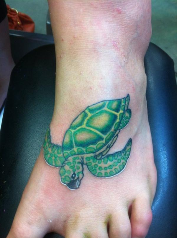 green turtle on foot 30 Jazzy Turtle Tattoos
