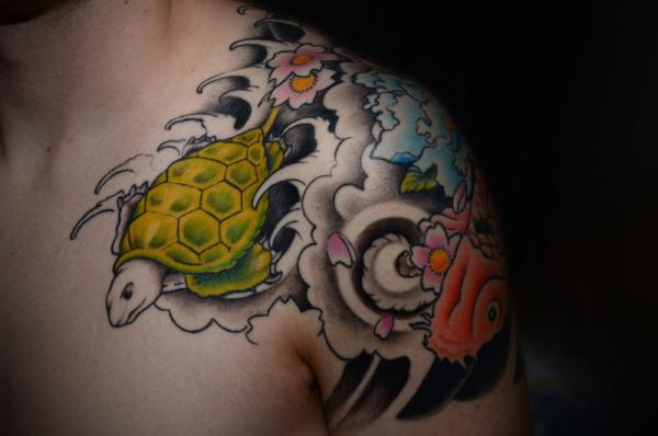 rushing turtle off shoulder 30 Jazzy Turtle Tattoos