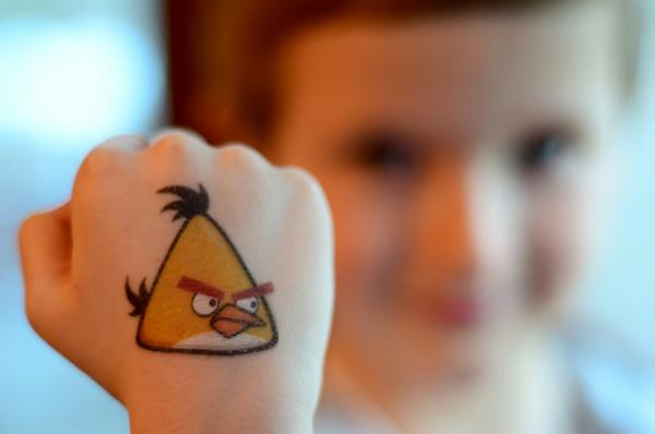 angry bird fist 85 Mind Blowing Bird Tattoos