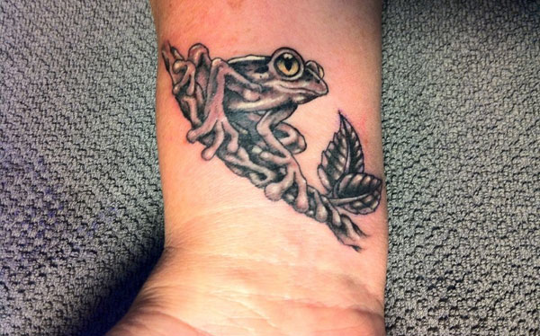 Frog tattoo on wrist
