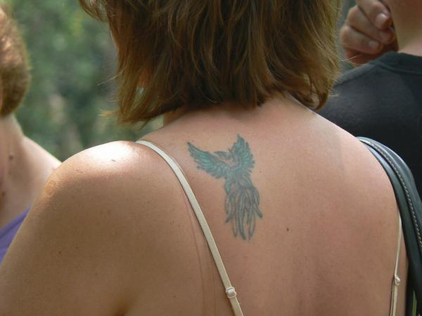 Woman With Phoenix Tattoo