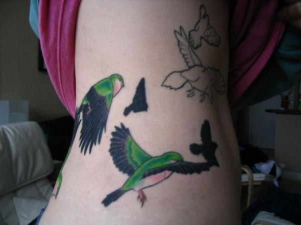bird tattoo colour side 40 Remarkable Side Tattoos For Girls