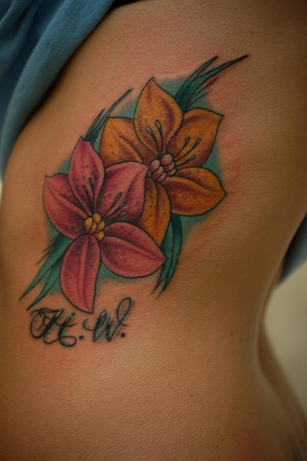 flower tattoo 40 Remarkable Side Tattoos For Girls