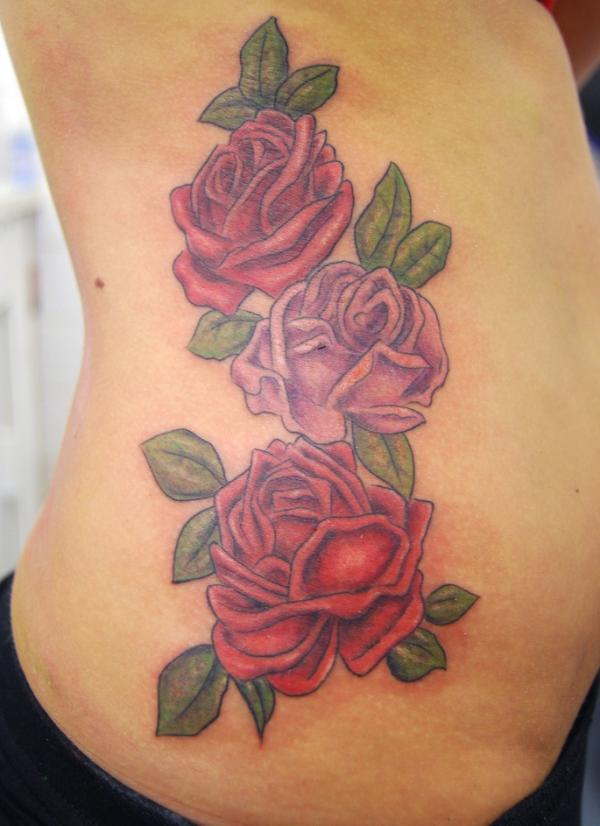 roses on side 40 Remarkable Side Tattoos For Girls