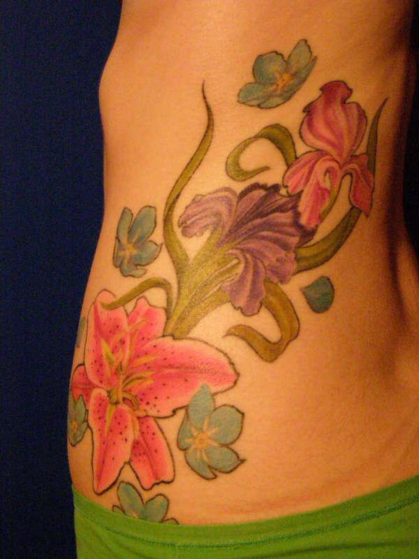 side of flower 40 Remarkable Side Tattoos For Girls