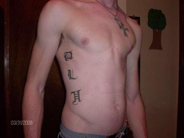 Guy Initials Tattoo