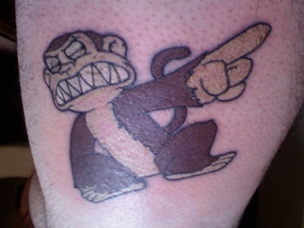 evil monkey 30 Stupid Tattoos You Shouldnt Miss To Check Out