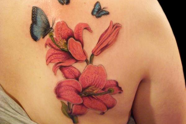lilly flower and butterfly 35 Beautiful Tattoos You Should Check Right Away