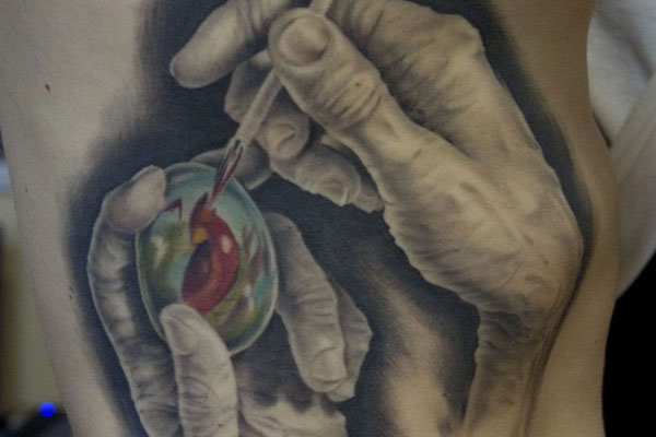 Hands Painting Egg