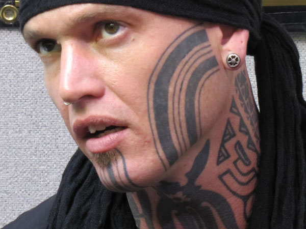 Great Face And Neck Tattoo