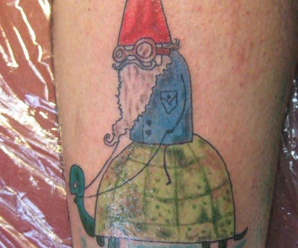 gnome riding a turtle 20 Spectacular Gnome Tattoo Designs