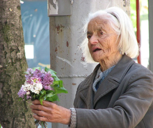Old Woman Selling Flowers