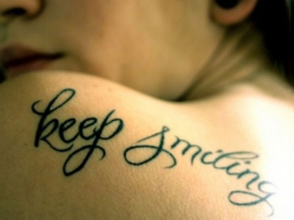 keep smiling 30 Inspirational Tattoos You Should Check Right Now