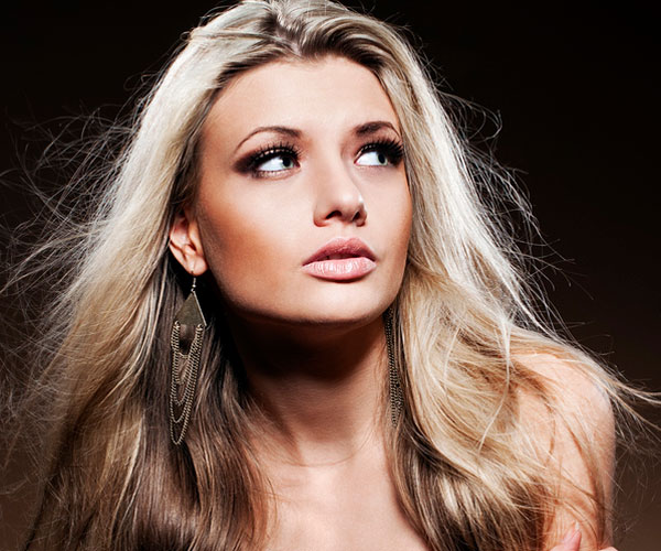 young woman 30 Fascinating Long Hairstyles For Round Faces
