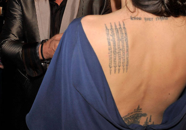 blue dress 20 Sexy Angelina Jolie Tattoos