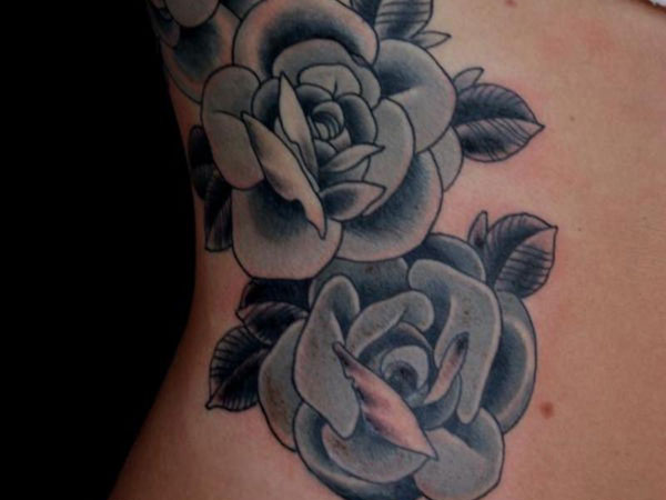 rib tattoo 30 Exotic Black Rose Tattoo Designs