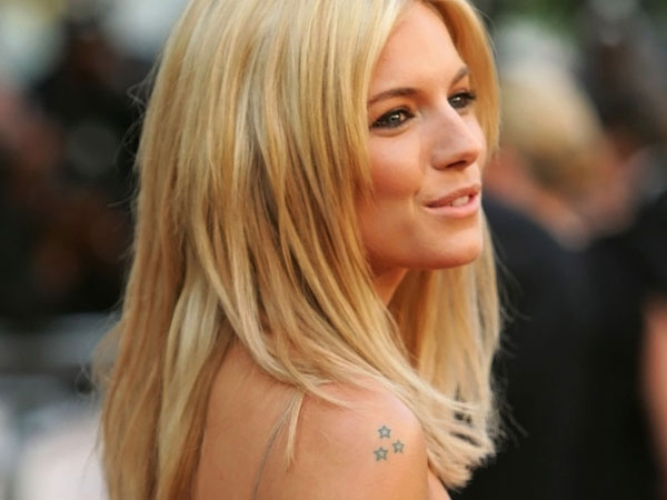 sienna miller 25 Awesome Celebrity Tattoos Female