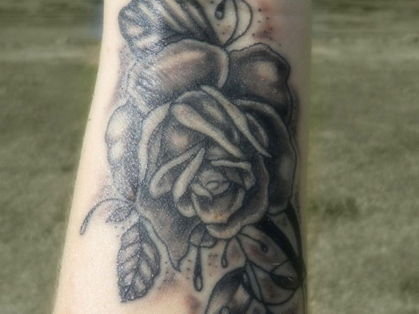 rose on my wrist 50 Hair Raising Feminine Tattoos