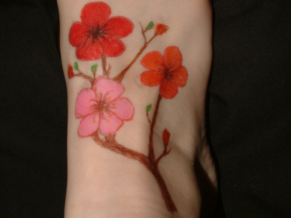 the cherry blossom 50 Hair Raising Feminine Tattoos