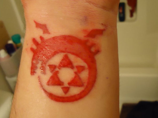 red tattoo 25 Fantastic Ouroboros Tattoo Collection