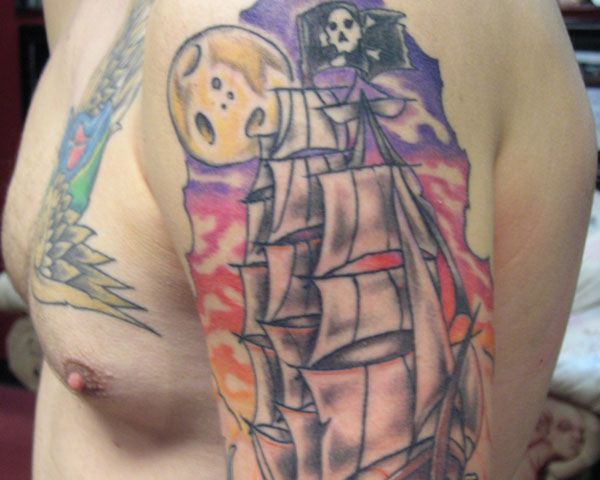 pirate ship on the waves 30 Mind Blowing Pirate Tattoos