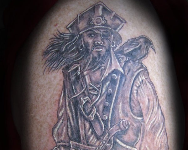 pirate with crow 30 Mind Blowing Pirate Tattoos