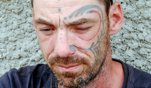 Loathsome Face Tattoo