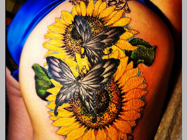 sunflower with butterfly 35 Tremendous Sunflower Tattoo Designs