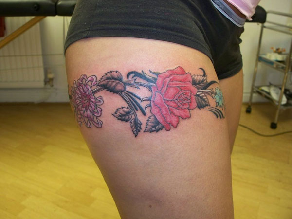 rose band leg tattoo 40 Incredible Thigh Tattoos
