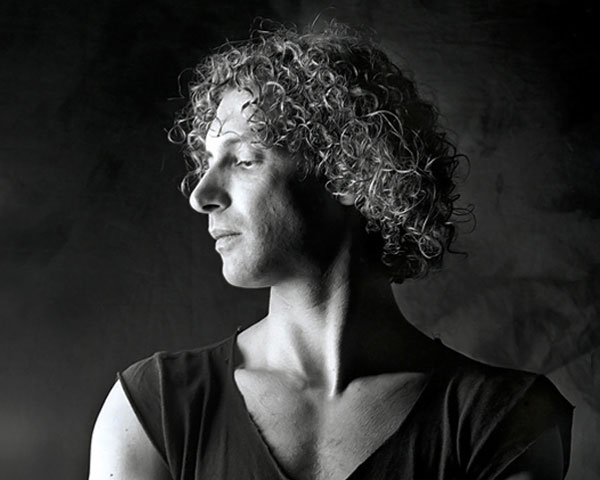 the dancer 30 Spectacular Curly Hairstyles For Men