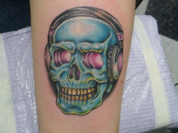 skull with headphones 30 Mind Blowing Elbow Tattoos