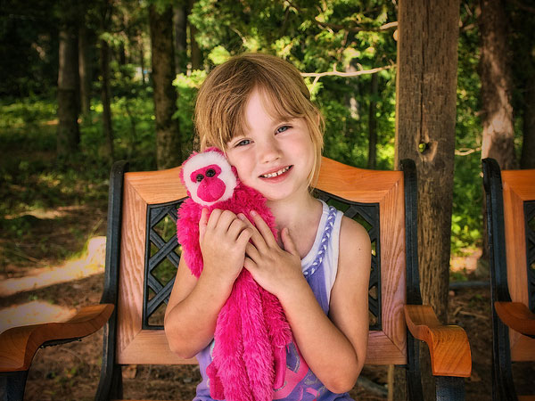 girl with stuffed monkey 30 Mind Blowing Hairstyles For Kids
