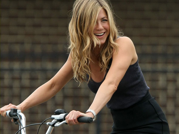 riding bicycle 40 Exciting Jennifer Aniston Pictures