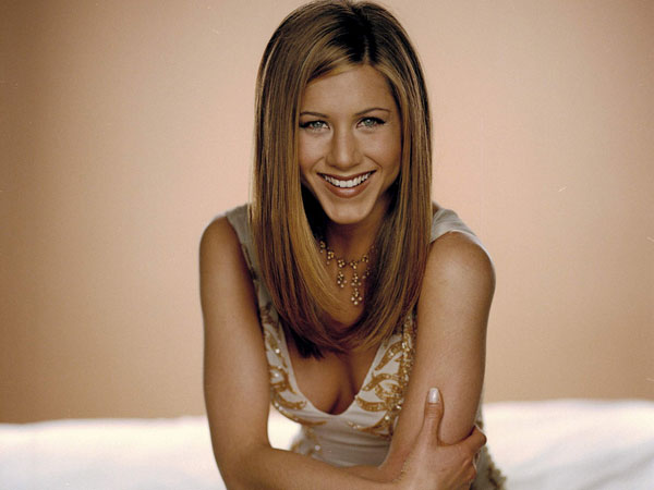 sitting on bed 40 Exciting Jennifer Aniston Pictures