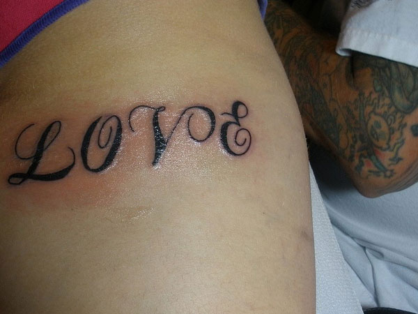 Love Tattoo on the Arm
