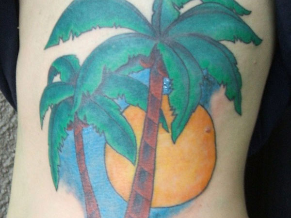 rib tattoo 25 Spectacular Palm Tree Tattoo Designs