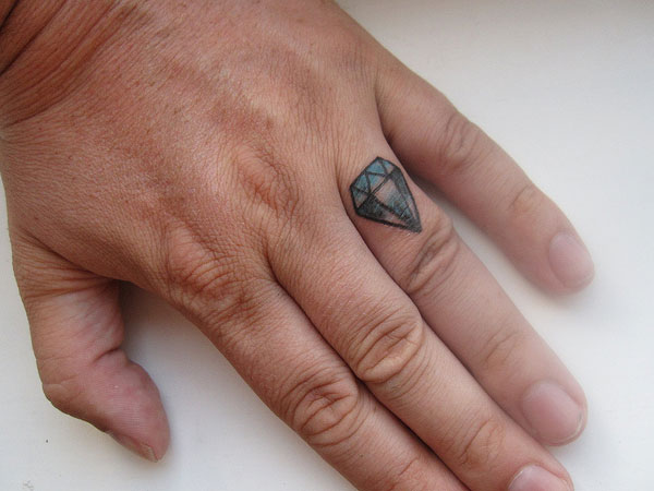 old school diamond 25 Marvelous Ring Finger Tattoos