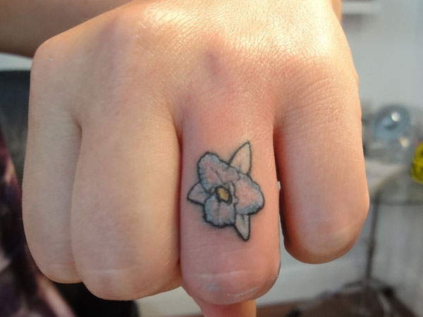 orchid ring finger 25 Marvelous Ring Finger Tattoos
