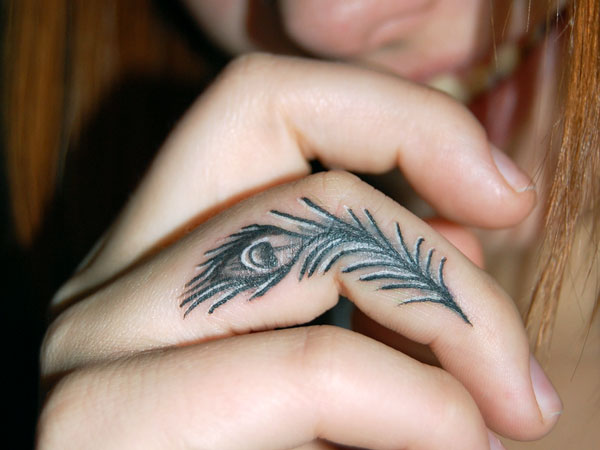 peacock feather tattoo 25 Marvelous Ring Finger Tattoos