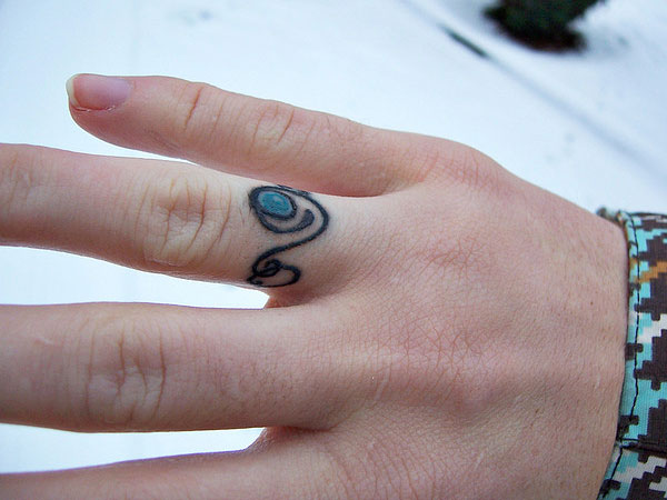 unconventional tattoo 30 Glamorous Wedding Ring Tattoos