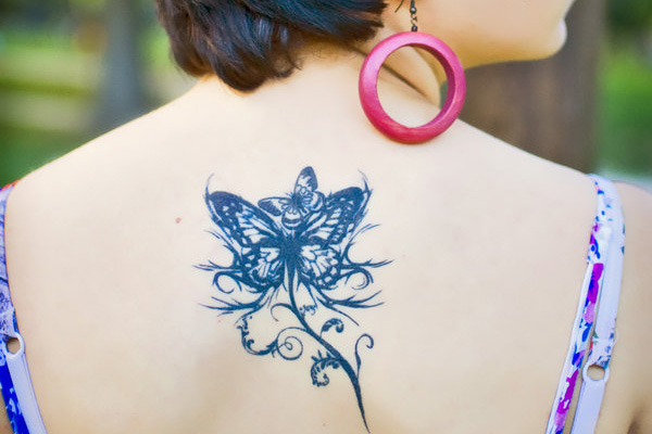 back floral butterfly 20 Exciting Butterfly and Flower Tattoos