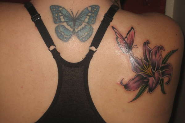back flower and butterfly 20 Exciting Butterfly and Flower Tattoos