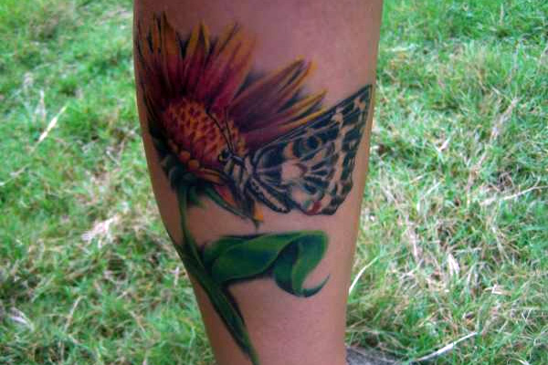 sun flower and butterfly 20 Exciting Butterfly and Flower Tattoos