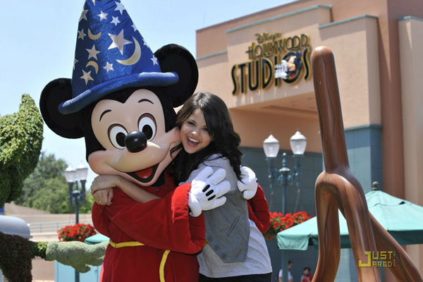 mickey with selena 25 Lovely Mickey Mouse Pictures