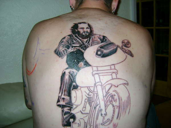first sitting tattoo 20 Tremendous Motorcycle Tattoos