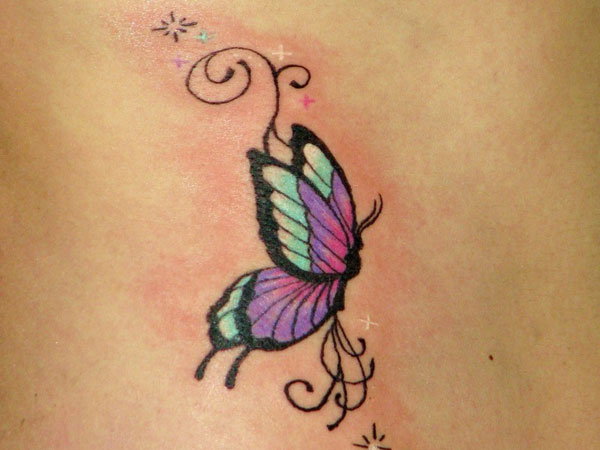 butterfly on her ribs 25 Superb Small Butterfly Tattoos