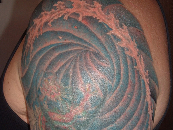 cresting wave tattoo 25 Magical Wave Tattoos