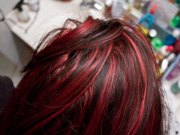 red hair strands combine with darker shades of red in this freshly ...