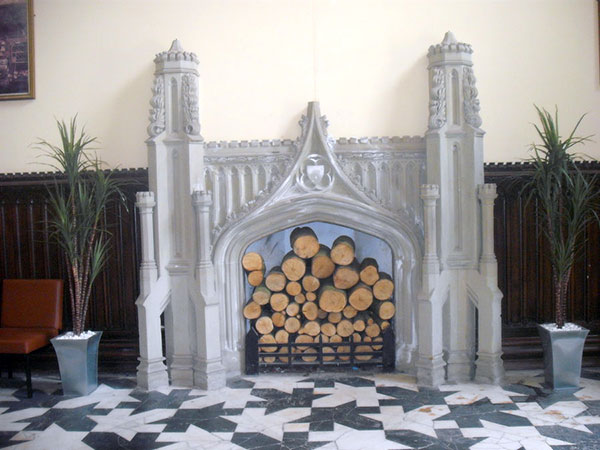 Logs Surround Fireplace